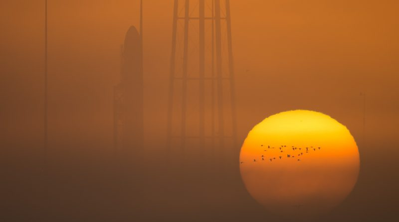 The Orbital ATK Antares rocket, with the Cygnus spacecraft onboard, is seen on launch Pad-0A during sunrise, Sunday, Oct. 16, 2016 at NASA's Wallops Flight Facility in Virginia. Orbital ATK's sixth contracted cargo resupply mission with NASA to the International Space Station will deliver over 5,100 pounds of science and research, crew supplies and vehicle hardware to the orbital laboratory and its crew. Photo Credit: (NASA/Bill Ingalls)