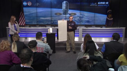 Gary Ruff, SAFFIRE Investigator, demonstrates the size of the combustion sample to media - Photo: NASA