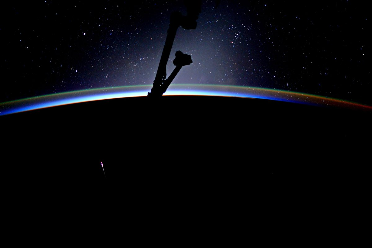 astronaut jack fischer captured this picture of dragon s re entry dragon is leading the way the disintegrating object behind it is the trunk section