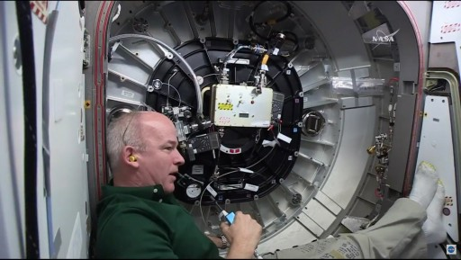 Jeff Williams working in the hatchway to BEAM - Photo: NASA TV