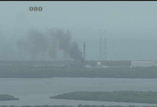 Smoke still rises from SLC-40 three hours after the incident - Photo: NASA KSC Webcam