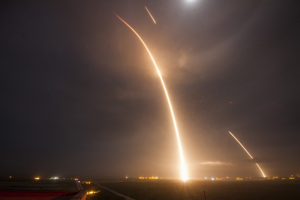 Long Exposure of Monday night's accomplishments, picturing the ascent of the Falcon 9 rocket from its launch pad, the short re-entry burn and the final landing burn to a safe touchdown in Landing Zone 1 - Credit: SpaceX