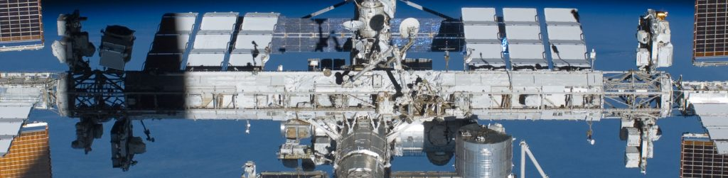 ISS with its Integrated Truss Structure & MT Railway System - The Mobile Transporter and the two CETA Carts can be seen just to the right, off center - Photo Credit: NASA