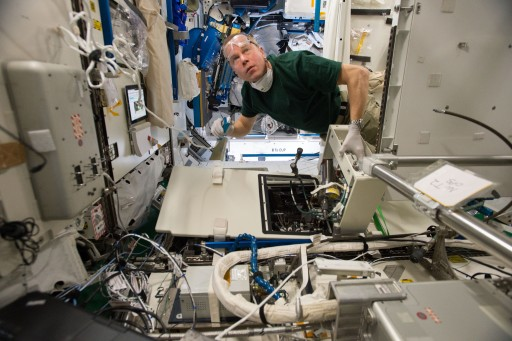 Tim Kopra conducting Urine Processing Assembly - Photo: NASA