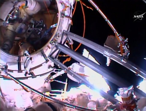 Yuri Malenchenko, still inside the airlock, as seen by Sergei Volkov from the EVA Ladder. - Photo: NASA TV