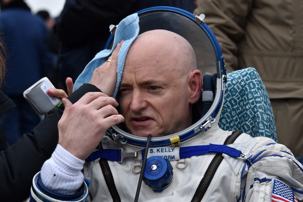 International Space Station (ISS) crew member Scott Kelly of the U.S. reacts after landing near the town of Dzhezkazgan, Kazakhstan, on March 2, 2016. US astronaut Scott Kelly and Russian cosmonaut Mikhail Kornienko returned to Earth on March 2 after spending almost a year in space in a ground-breaking experiment foreshadowing a potential manned mission to Mars. AFP PHOTO / POOL / KIRILL KUDRYAVTSEV