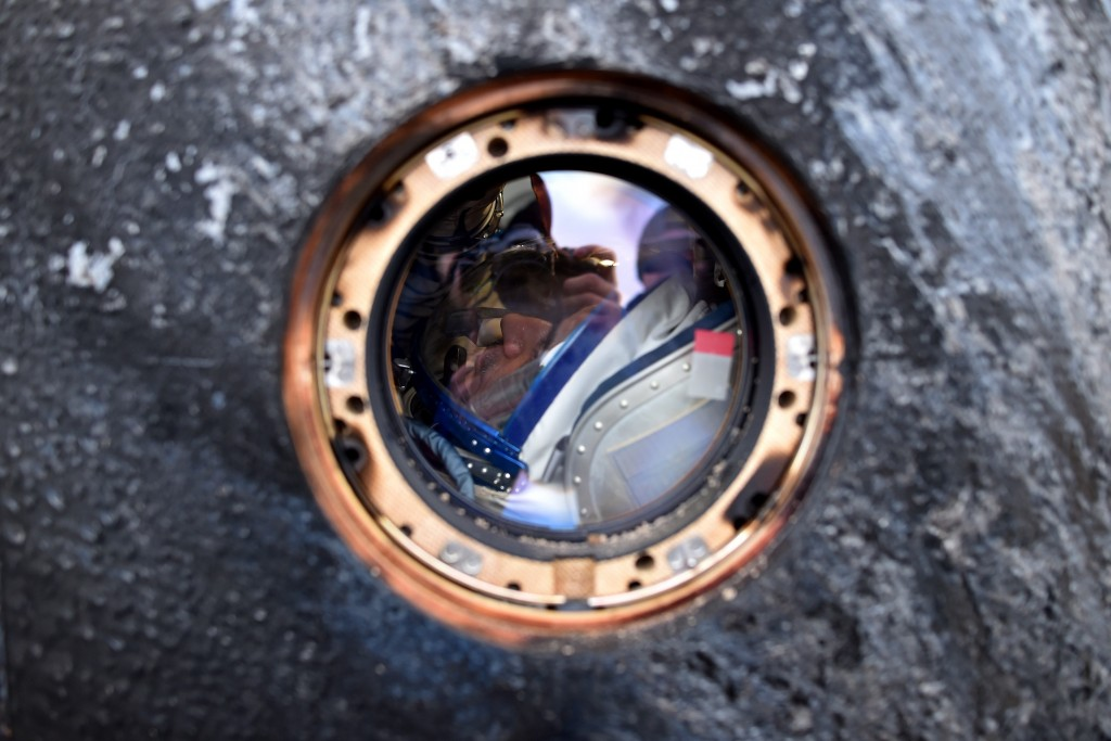International Space Station (ISS) crew member Mikhail Kornienko of Russia is seen inside the Soyuz TMA-18M space capsule after landing near the town of Dzhezkazgan, Kazakhstan, on March 2, 2016. US astronaut Scott Kelly and Russian cosmonaut Mikhail Kornienko returned to Earth on March 2 after spending almost a year in space in a ground-breaking experiment foreshadowing a potential manned mission to Mars. AFP PHOTO / POOL / KIRILL KUDRYAVTSEV