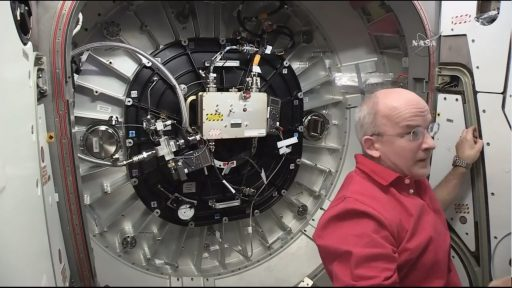 Williams working in the hatchway to BEAM - Photo: NASA TV