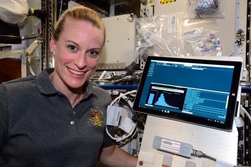 NASA Astronaut Kate Rubins with the Biomolecule Sequencer hardware after the first DNA Sequencing was performed on ISS - Photo: NASA