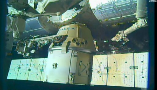 Monitoring Dragon Solar Arrays Clearance - Photo: NASA TV