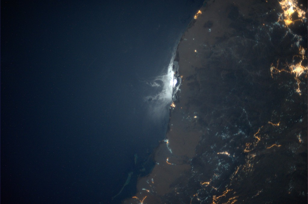 The moon is reflected off the low waters south of Mecca