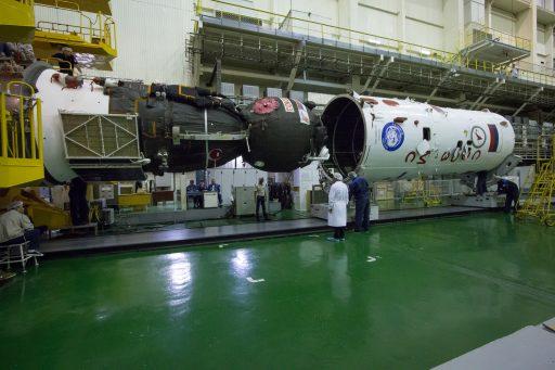Payload Shroud Installation - Photo: NASA/Victor Zelentsov