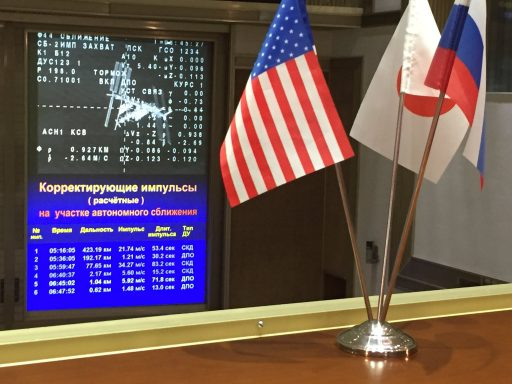 Screens at Mission Control Moscow show the data overlay from the Soyuz spacecraft during the close approach phase of the Rendezvous - Photo: NASA/Bill Ingalls