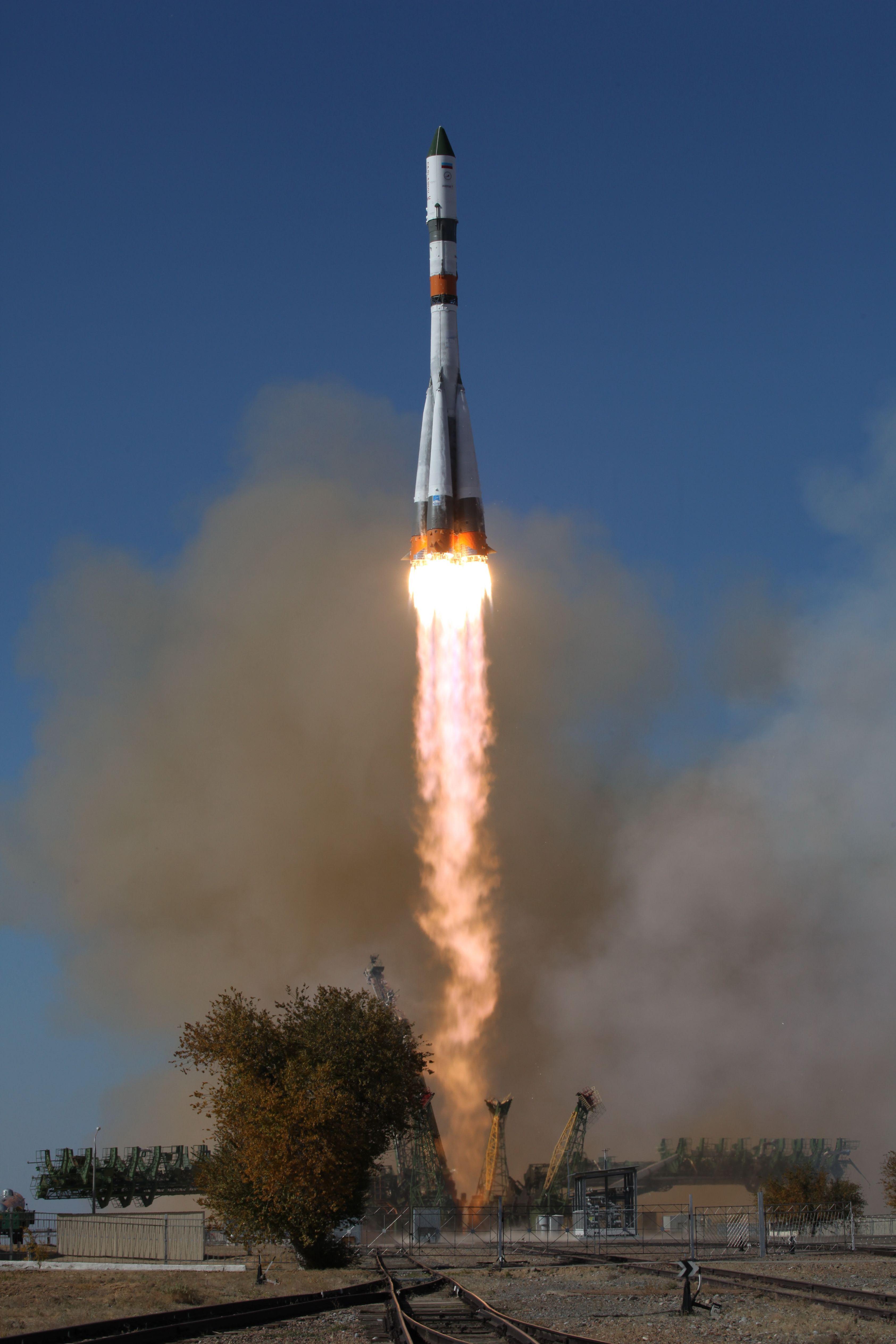photos  soyuz rocket blazes into clear skies to dispatch