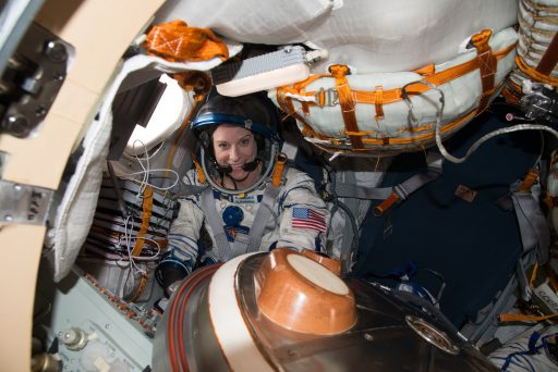 Kate Rubins completes a fit check in her Sokol Suit and Kazbek Seat Liner in the Soyuz Entry Module - Photo: NASA