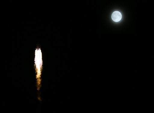 Long March 2F passes the Moon on its way into orbit - Photo: Xinhua (modified by Spaceflight101)