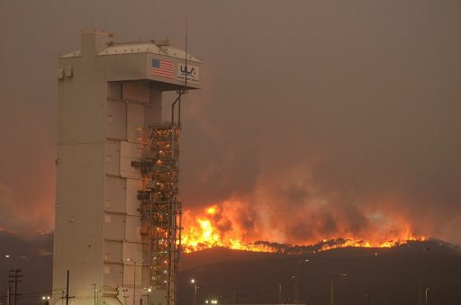 Flames approach the Atlas V rocket housed inside its Service Tower at Space Launch Complex 3 - Photo: Santa Barbara County Fire Dept