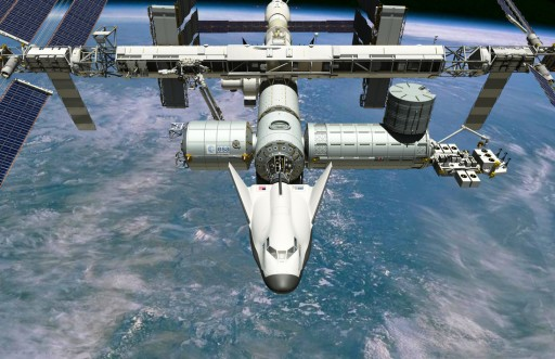 Artist's illustration of Dream Chaser docked to ISS - Image: Sierra Nevada