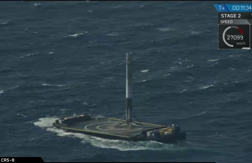 Falcon 9 first stage standing upright atop the Drone Ship after a milestone landing - Photo: SpaceX Webcast