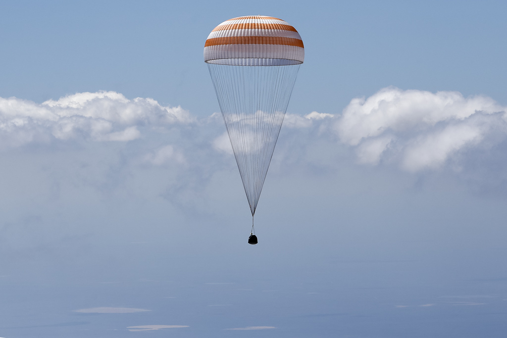 Soyuz TMA-19M spacecraft capsule carrying ISS crew members Peake of Britain, Malenchenko of Russia and Kopra of U.S. descends beneath parachute near Dzhezkazgan