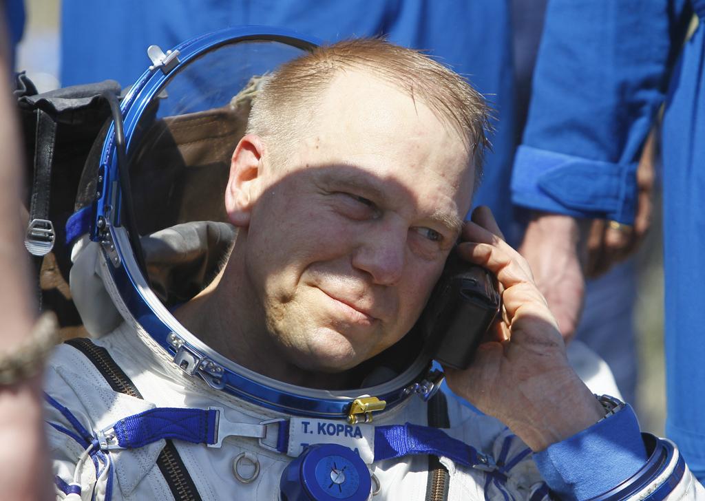 Member of ISS crew Kopra of U.S. speaks on satellite phone shortly after landing near Dzhezkazgan