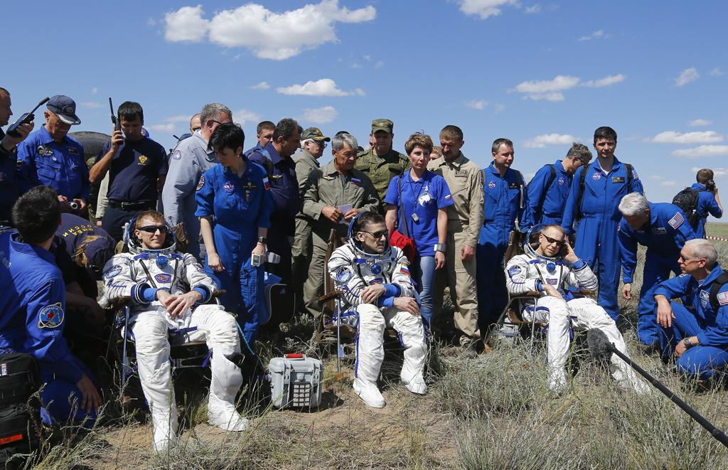 The ISS crew members Timothy Peake of Britain, Yuri Malenchenko of Russia and Timothy Kopra of the U.S. rest shortly after landing near Dzhezkazgan