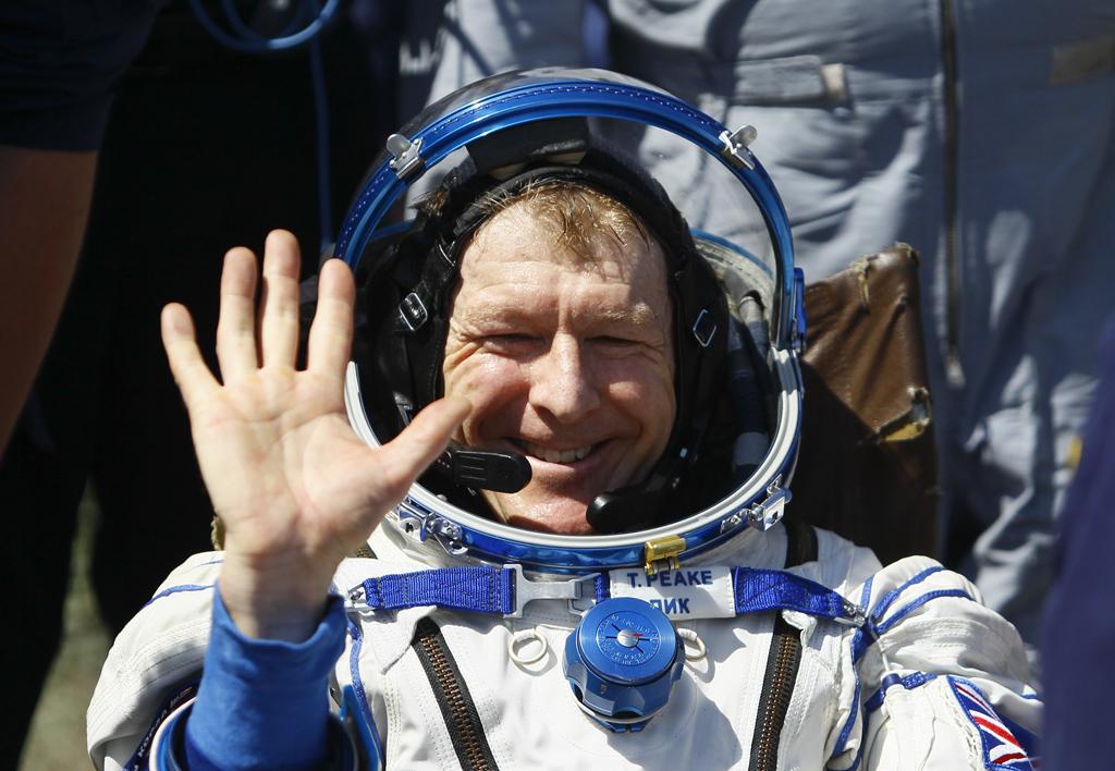 Member of ISS crew Peake of Britain waves after landing near Dzhezkazgan