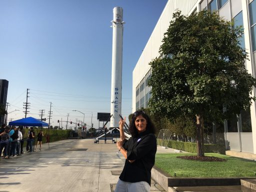 NASA Astronaut Suni Williams in front of the Orbcomm G2 Booster on display at SpaceX HQ - Photo: Sunita Williams/Twitter