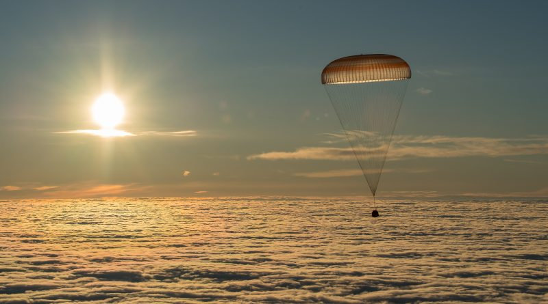 Soyuz Parachutes to Safe Landing on Snow-Covered Kazakh Steppe with U.S.-Russian Crew Trio